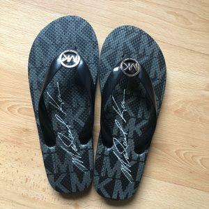 Michael Kors flip flops. Size 6.